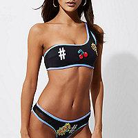 Haut de bikini asymétrique noir à écusson appliqué
