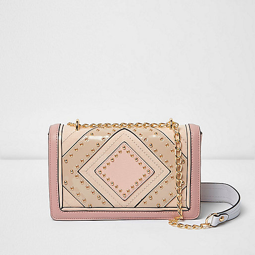 Pink stud and eyelet mini cross body bag