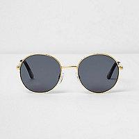 Goldene Sonnenbrille mit getönten Gläsern