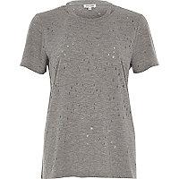 T-shirt troué gris avec encolure à lanières