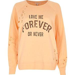 Coral nibbled print sweatshirt