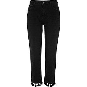 Zwarte rechte jeans met pompons aan de zoom