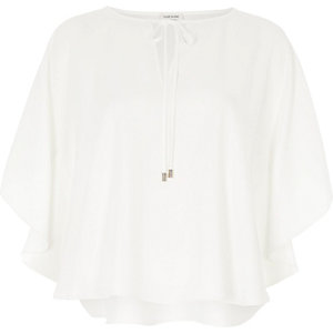 Cream poncho top