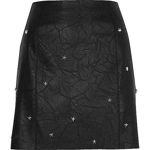 Black faux leather studded mini skirt