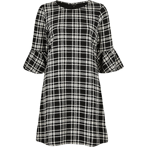 Black and white check flute sleeve dress