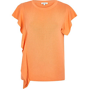 Top orange avec volants sur le devant