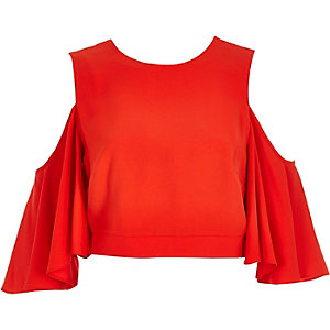 Red cold shoulder trumpet sleeve top