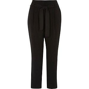 Zwarte smaltoelopende broek met pied-de-poule motief