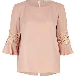 Pink crochet trim trumpet sleeve top