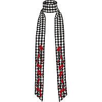 Zwarte en witte smalle sjaal met gingham-ruit en bloemenprint
