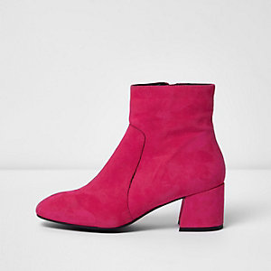 Bright pink suede block heel ankle boots