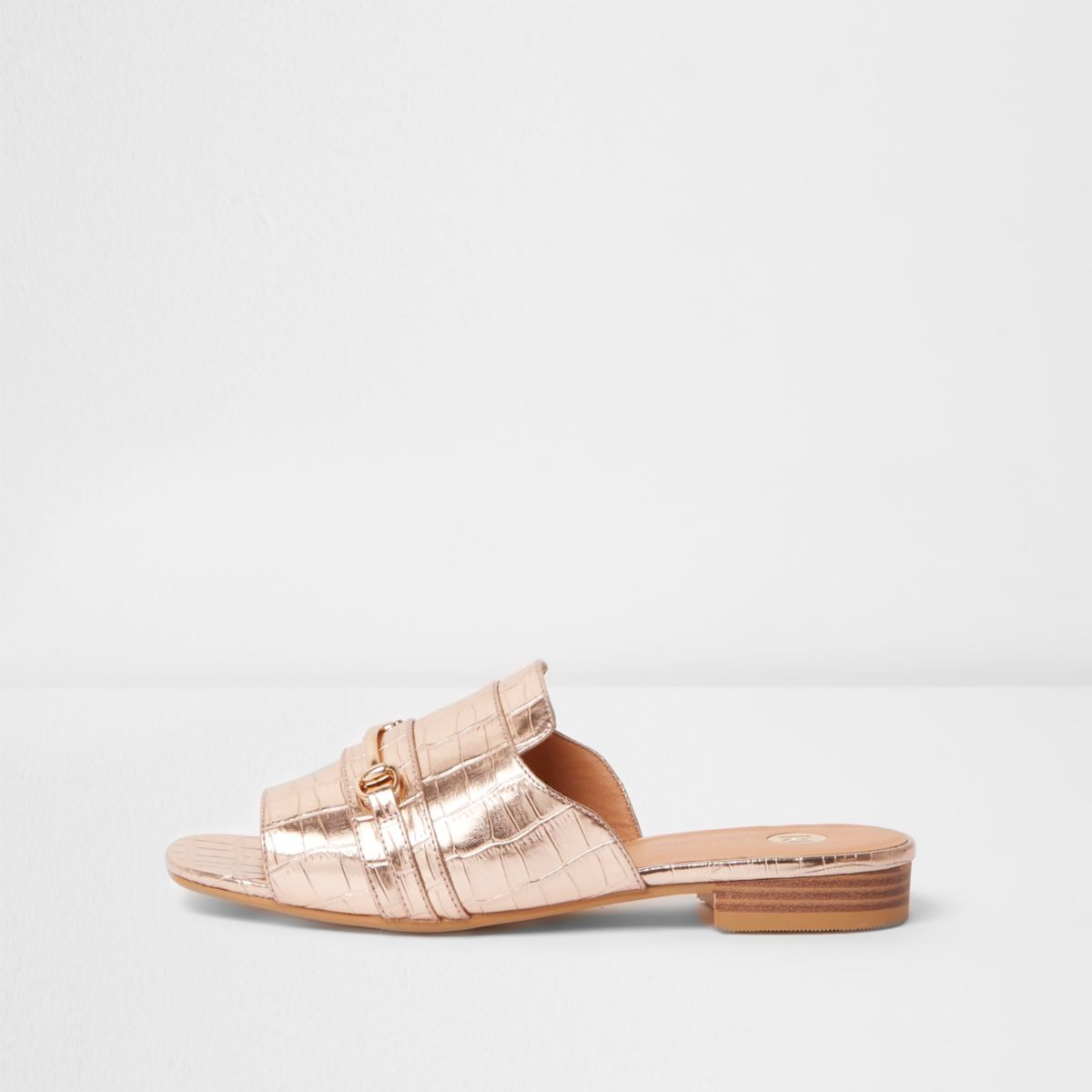 Rose gold metallic snaffle backless loafers