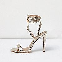 Sandales à brides dorées effet cage coupe large