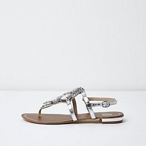 Flache Sandalen mit Ziersteinchen in Silber-Metallic