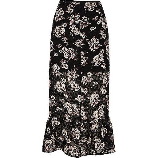 Jupe mi-longue à fleurs noire avec volant à l'ourlet