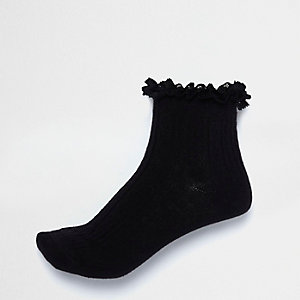 Schwarze Socken mit Zopfmuster