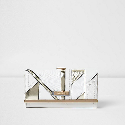 White metallic panel foldover clip top purse