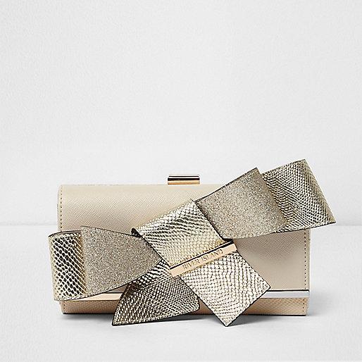 Gold clip top bow purse