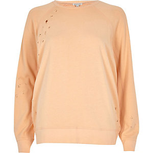 Sweat orange clair aspect usé
