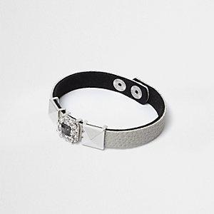 Bracelet clouté et à strass gris
