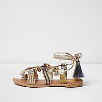 Gold metallic leather charm ankle tie sandals