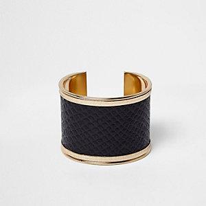 Manchette dorée en cuir synthétique grain serpent