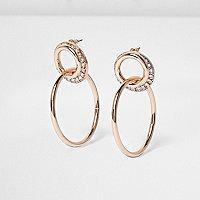 Boucles d'oreilles façon or rose à anneaux entrelacés