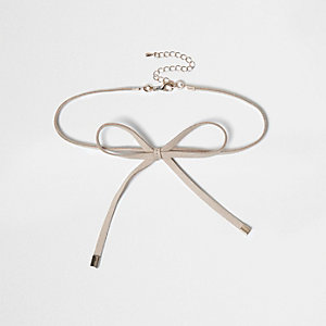 Nude chokerketting met strik