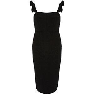 Robe noire moulante à manches à volants