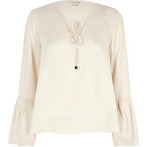 Cream tie front bell sleeve top