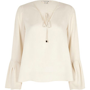 Cream tie front trumpet sleeve top