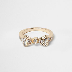 Gold tone gem encrusted bow ring