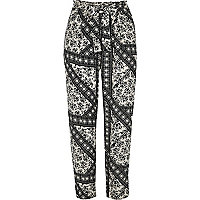 Black floral print tie waist tapered trousers