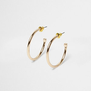 Gold tone cube back hoop earrings