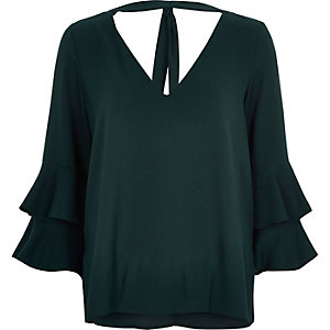 Dark green trumpet sleeve top