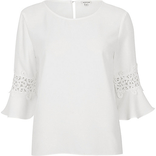 White lace insert trumpet sleeve top