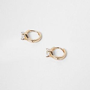 Clous d'oreilles forme anneau dorés avec pierre incrustée