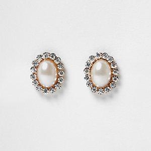 Clous d'oreilles dorés avec perle entourée de pierres fantaisie