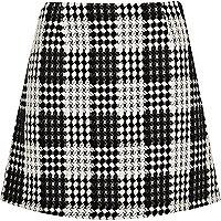 Mini-jupe trapèze à carreaux noire et blanche
