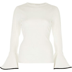 Cream trumpet sleeve fitted top