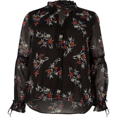 Zwarte blouse met lange mouwen ruches en bloemenprint