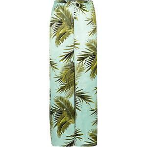 Pantalon de pyjama palazzo imprimé palmiers bleu