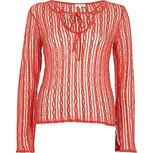 Oranje top van opengewerkt mesh met vetersluiting voor