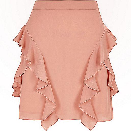 Mini-jupe trapèze en mousseline rose à volant