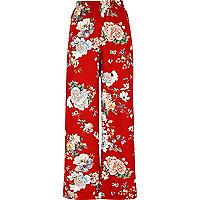 Pantalon large à fleurs rouge taille haute