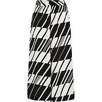 Jupe-culotte large coupe courte imprimé géométrique noire et blanche