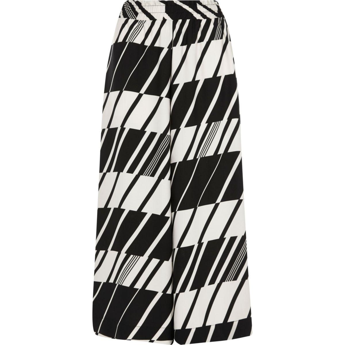 Zwart-witte cropped broekrok met geometrische print en wijde pijpen