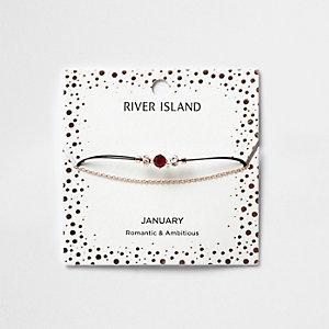 Rotes Armband mit Geburtsstein für den Monat Januar