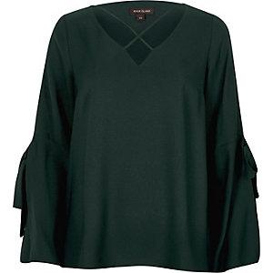 Dunkelgrüne Bluse mit geschlitzten Ärmeln