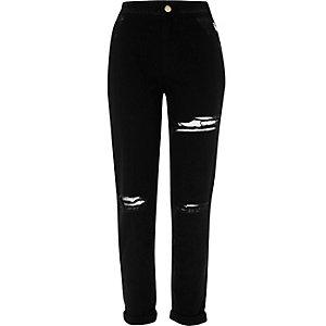 Pantalon fuselé noir à déchirures